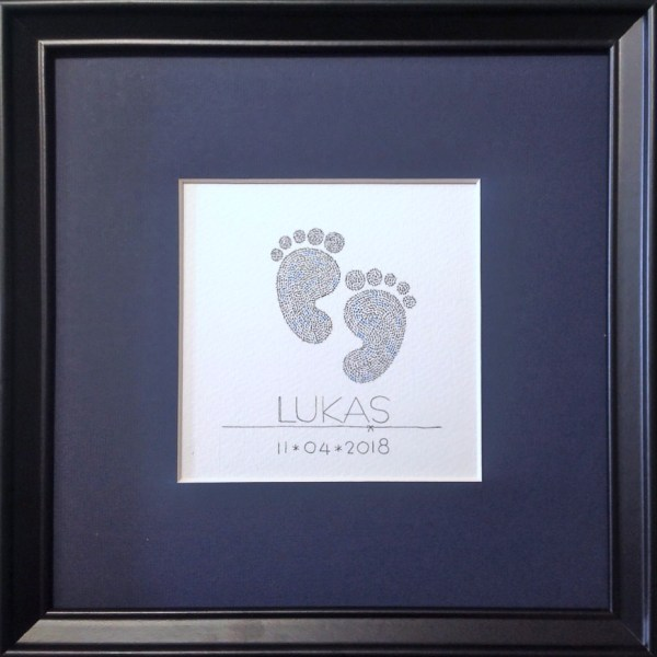 framed calligram of two babyfeet