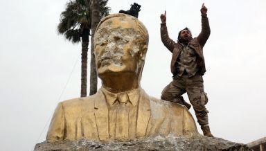 Protesters destroy statue of Hafiz Assad (father of Bashar Assad and leader of the Arab Socialist Ba'ath Party of Syria) credits: Salih Mahmud Leyla/Anadolu Agency via Getty Images