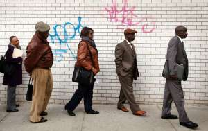 """Job seekers stand in line to attend the Dr. Martin Luther King Jr. career fair held by the New York State Department of Labor."" (Reuters / Lucas Jackson)"