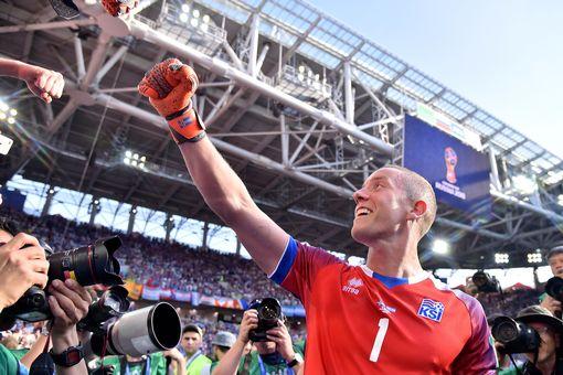 Hannes Halldorsson celebrates his save