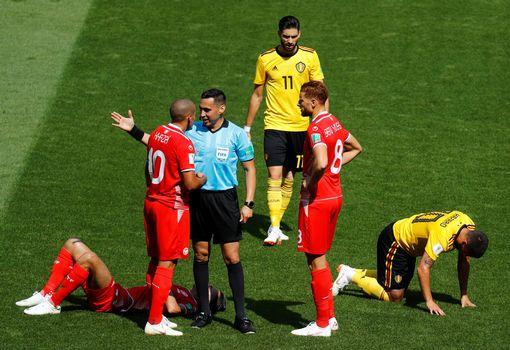Wahbi Khazri talks with referee Jair Marrufo