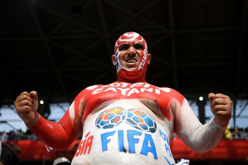 A Tunisia fan enjoys the atmosphere