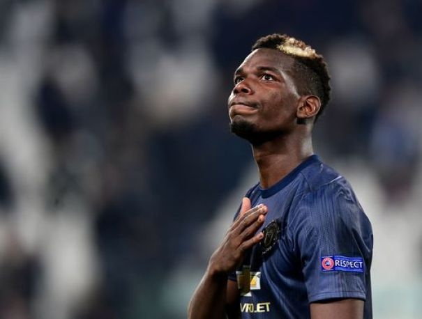 Manchester United's Paul Pogba acknowledges the public at the end of the match with Juventus