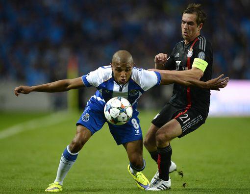 Porto's Yacine Brahimi (L) vies with Bayern Munich's Philipp Lahm