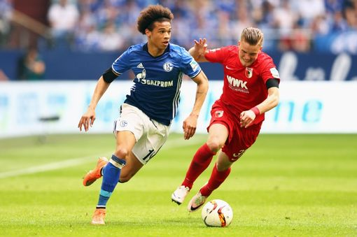 GELSENKIRCHEN, GERMANY - MAY 07: Leroy Sane of Schalke gets past the tackle from Philipp Max of FC Augsburg during the Bundesliga match between FC Schalke 04 and FC Augsburg held at Veltins-Arena on May 7, 2016 in Gelsenkirchen, Germany. (Photo by Dean Mouhtaropoulos/Bongarts/Getty Images)