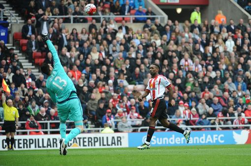 Jermain Defoe tries to chip Thibaut Courtois but is flagged offside