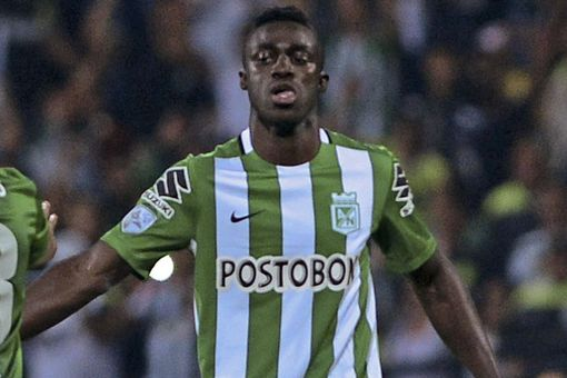 Davinson Sanchez celebrates with a team mate after scoring for Atletico Nacional against Sporting Cristal during a Libertadores Cup 2016 match on March 1, 2016