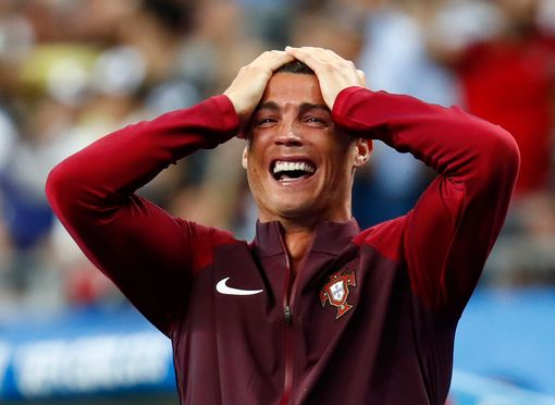 Cristiano Ronaldo reacts after Eder scores the first goal