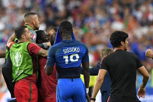 Eder celebrates with team mates after he scored