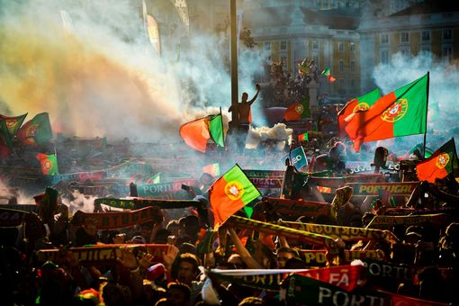 Portugal supporters wave flags at Terreiro do Paco square in Lisbon