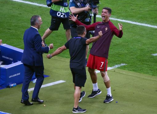 PARIS, FRANCE - JULY 10: Cristiano Ronaldo of Portugal celebrates with his team staffs after winning the tournament after the UEFA EURO 2016 Final match between Portugal and France at Stade de France on July 10, 2016 in Paris, France. (Photo by Alex Livesey/Getty Images)