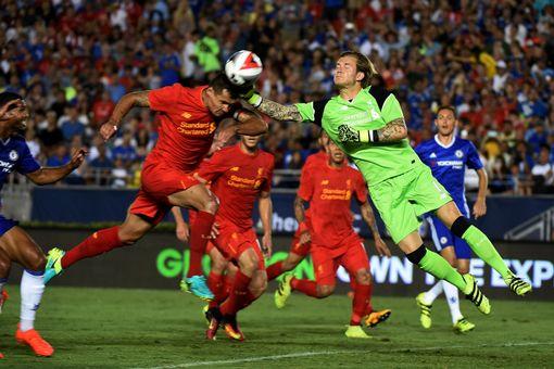 Loris Karius clashes with Dejan Lovren in front of goal