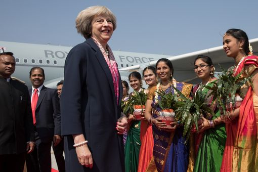 Theresa May is greeted at Bangalore's Kebpegowda International Airport