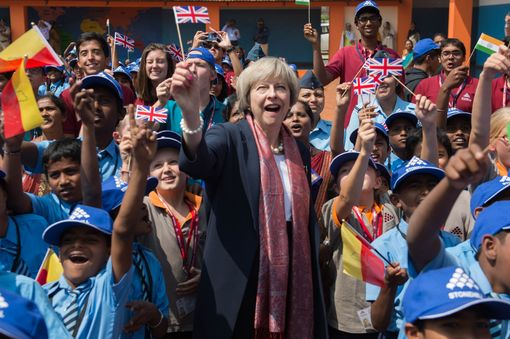 Prime Minister Theresa May watches a flypast by the Indian Air Force with pupils at Stonehill Government Primary School as she arrives in Bangalore on the final day of a three-day trade mission designed to pave the way for close commercial links with the south Asian giant after Brexit. PRESS ASSOCIATION Photo. Picture date: Tuesday November 8, 2016. See PA story POLITICS India. Photo credit should read: Stefan Rousseau/PA Wire