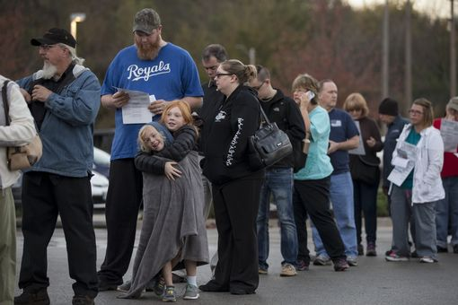 Brianna Taylor, 5, (L-R) and Cailin Taylor, 8, wait in line at a polling location with their parents, James and Lindsey Taylor on November 8, 2016 in Independence, Missouri