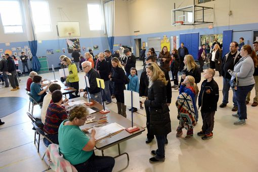People wait in line to vote at the Bishop Leo E. O'Neil Youth Center on November 8, 2016 in Manchester, New Hampshire