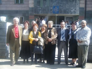 Principal of Vahan Tekeyan School of Gumri, Hovhannes Bedrosian (third from right), is surrounded by guests at the entrance of the school.