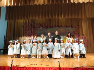 The graduating kindergarteners, with Armenian teacher Anahid Joubanian, Principal Houry Boyamian, Rev. Arakel Aljalian, Rev. Antranig Baljian and teacher Ani Changelian