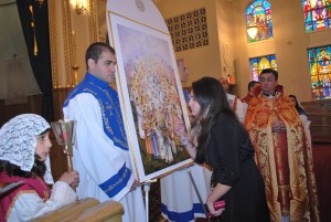 Alina Kouzouian, kissing the Icon of the Holy Martyrs at the conclusion of the Consecration Service.