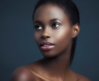 gorgeous african american woman with radiant skin. her decolletage is accentuated