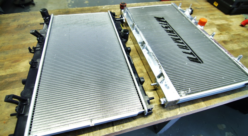 Mishimoto prototype 2 radiator (right) and stock radiator (left)