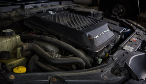 A top mount intercooler might save some time and cost in initial development, but it comes at a price. This mounting position is highly prone to heat-soak, especially with a limited flow of fresh air.