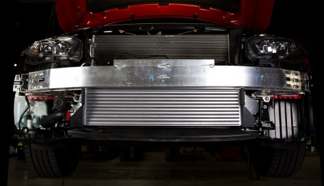 Our intercooler fills the space between the crash bar and the under body tray, maximizing the fin surface area.