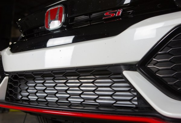 Even though the Si and Sport Hatch share the same front bumper cover, it never hurts to triple check your work. The taller and more prominent design complements the optional front lip on the Si.