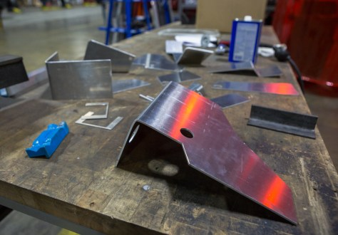 After the sections are cut, Mike uses a hydraulic press to form each piece into its specific shape.