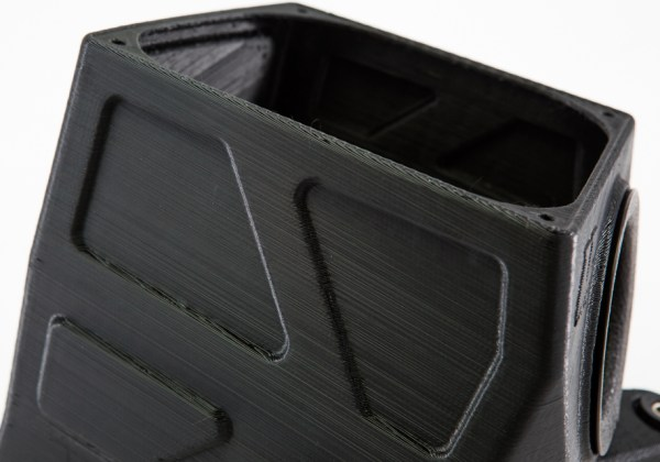 These grooves are more than just for looks. They're for added structural integrity. Our plan is for a linear low-density polyethylene (LLDPE) construction. While this is regarded as a strong plastic material, Ye still wanted to make sure it could stand up to the rigors of the Accord's engine bay. The eccentric design does just that.
