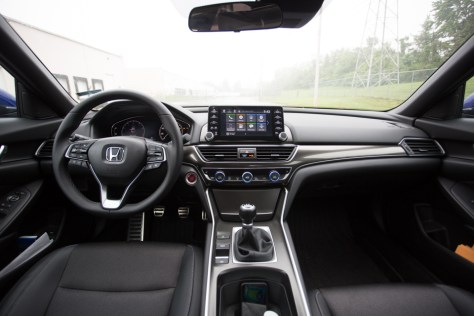In this day and age, it's not very common to still see three pedals in the driver's side footwell. Honda is keeping the sport side of the Sport trim alive with some good old-fashioned gear shifting.