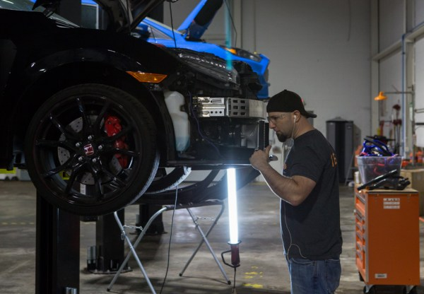 Our Director of Innovation, Eric Plebani, evaluates the potential mounting locations for our oil cooler kit amongst other possible cooling products.