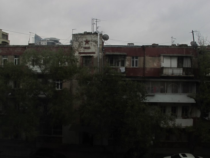 The view from my window, a red star hearkening back to Azerbaijan's Soviet past.
