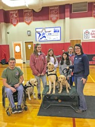 Densford has played an active role in educating others about service animals. He spoke at Sacred Heart School along with RFI trainer Kristy Armstrong (right).