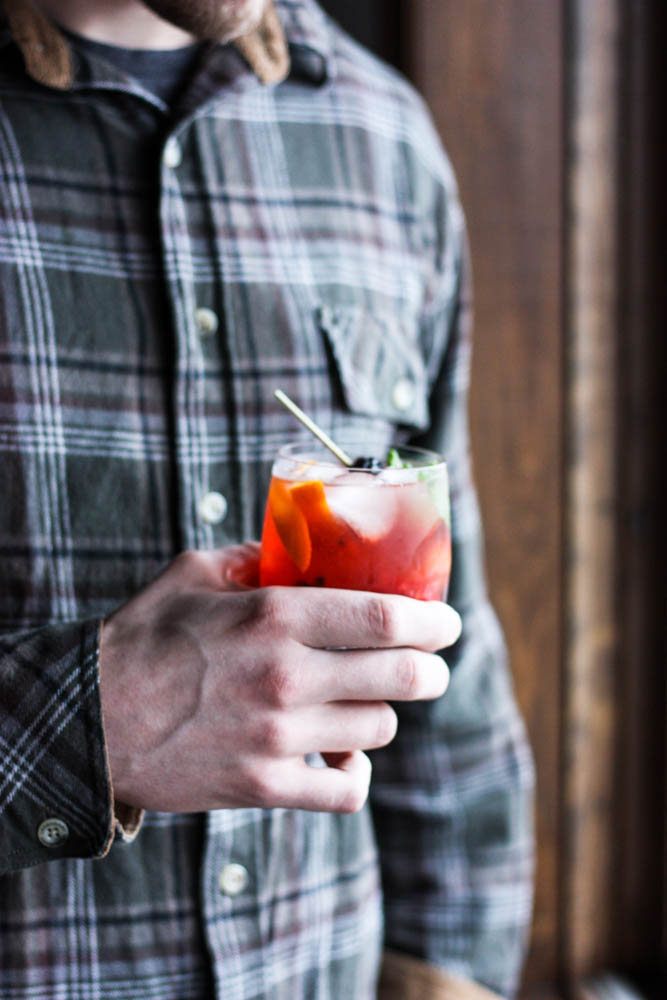 Man drinking an Old Fashioned