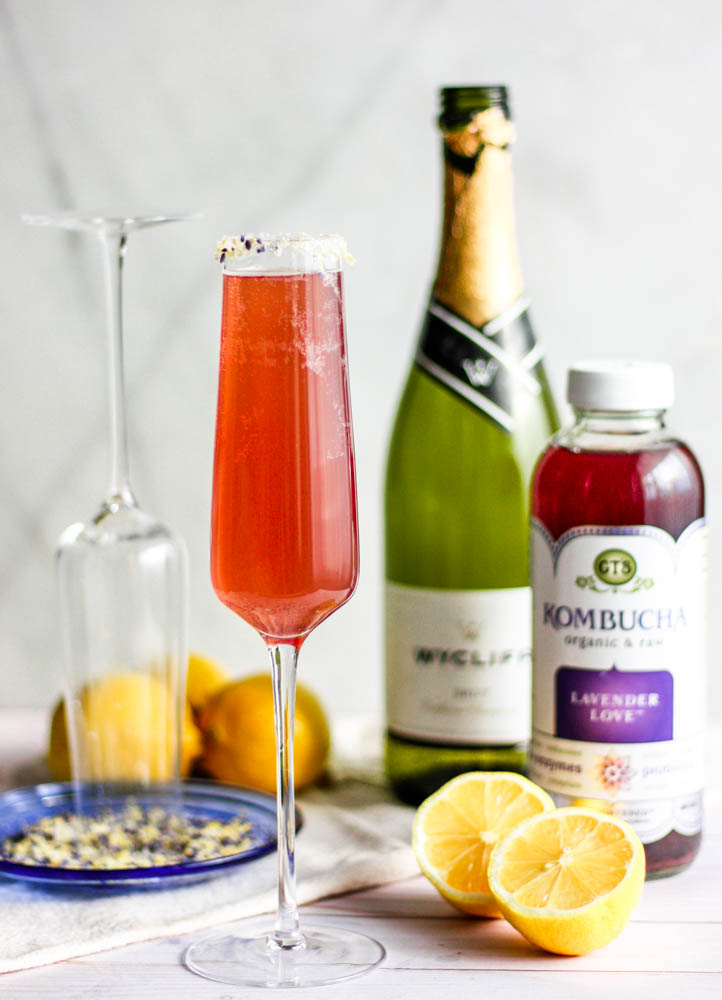 Easy Lavender Lemon Champagne Fizz Cocktails being made on grey marble