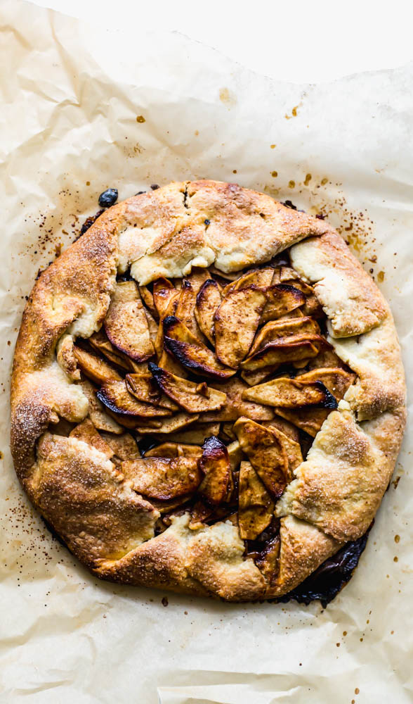 Rustic Apple Galette - If you're afraid of making pie - this Rustic Apple Galette is easier than pie - literally. The perfect apple filling is easily folded into my favorite, buttery pastry crust. Cinnamon and coconut sugar bring out the flavors of the fresh apple in this sweet treat. This is the perfect pastry for a beginner baker. #pastry #apple #applepie #baking #homemade #sweets #dessert