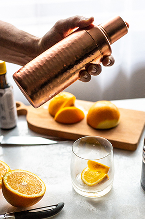 shaking a copper cocktail shaker
