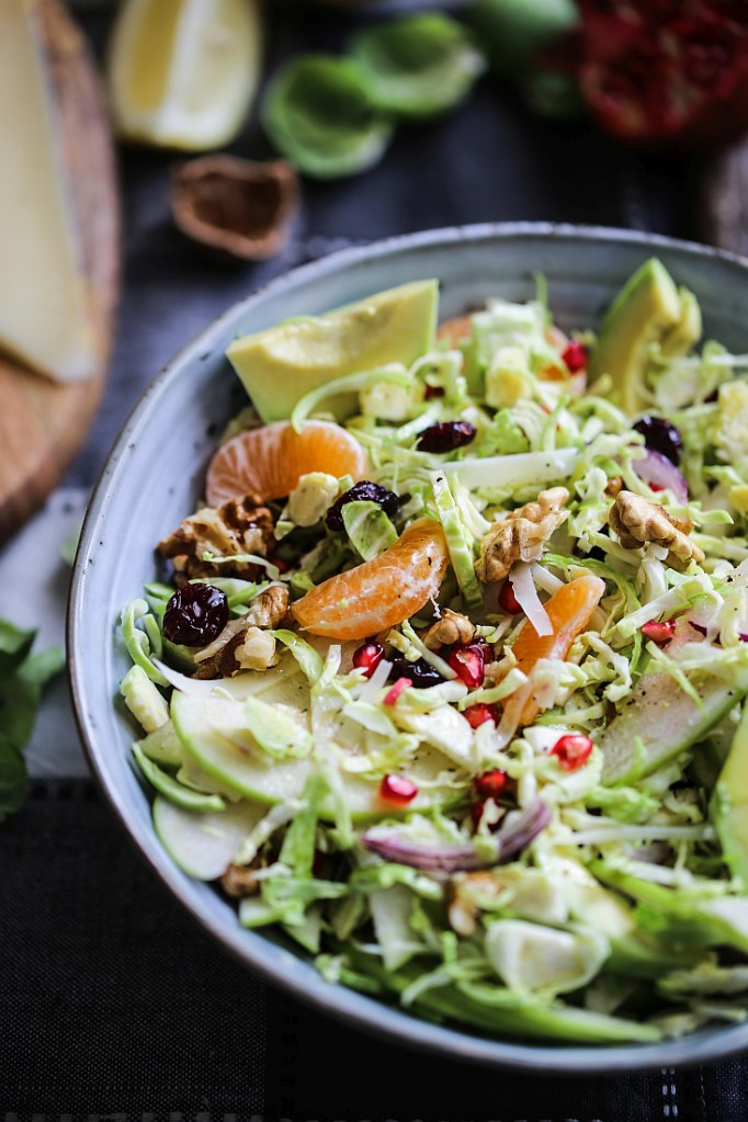Brussel sprouts avocado green apple salad with cranberries and pomegranate seeds