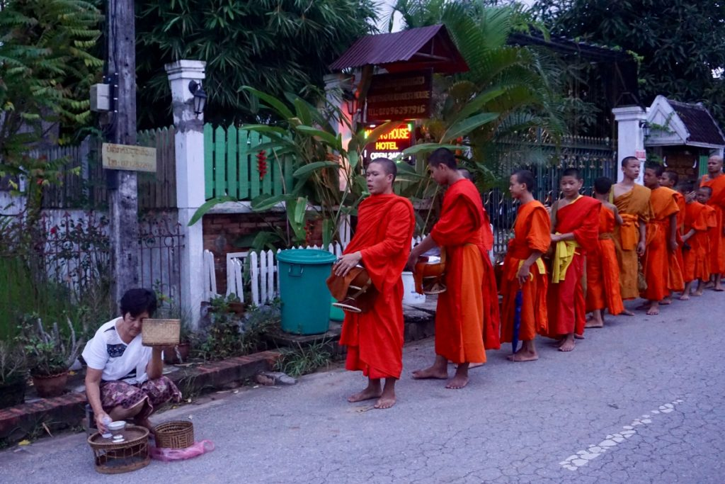 Laos monks almsgiving
