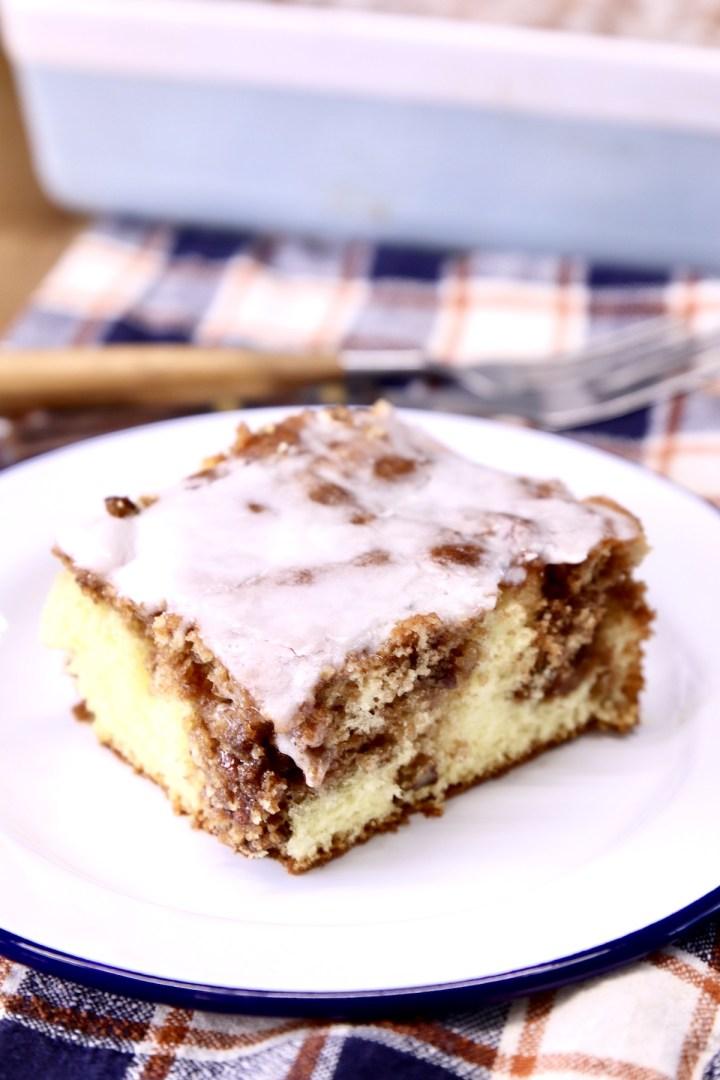 Slice of cinnamon coffee cake with powdered sugar icing