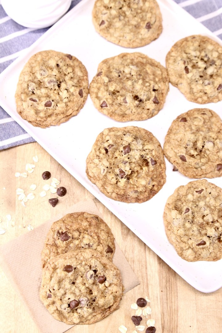 oatmeal chocolate chip cookies on a platter + 2 on a napkin