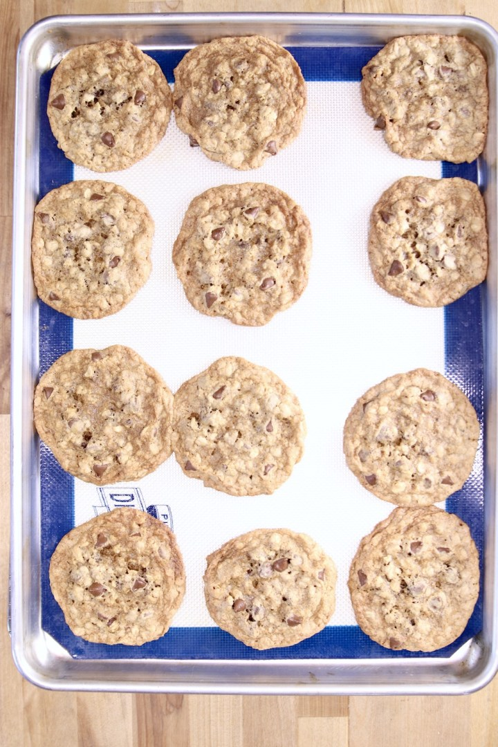 baked chocolate chip cookies on a silpat lined baking sheet