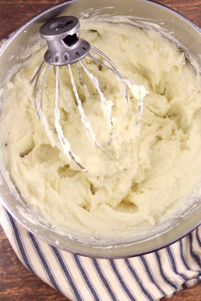 Bowl of whipped potatoes with whisk attachment