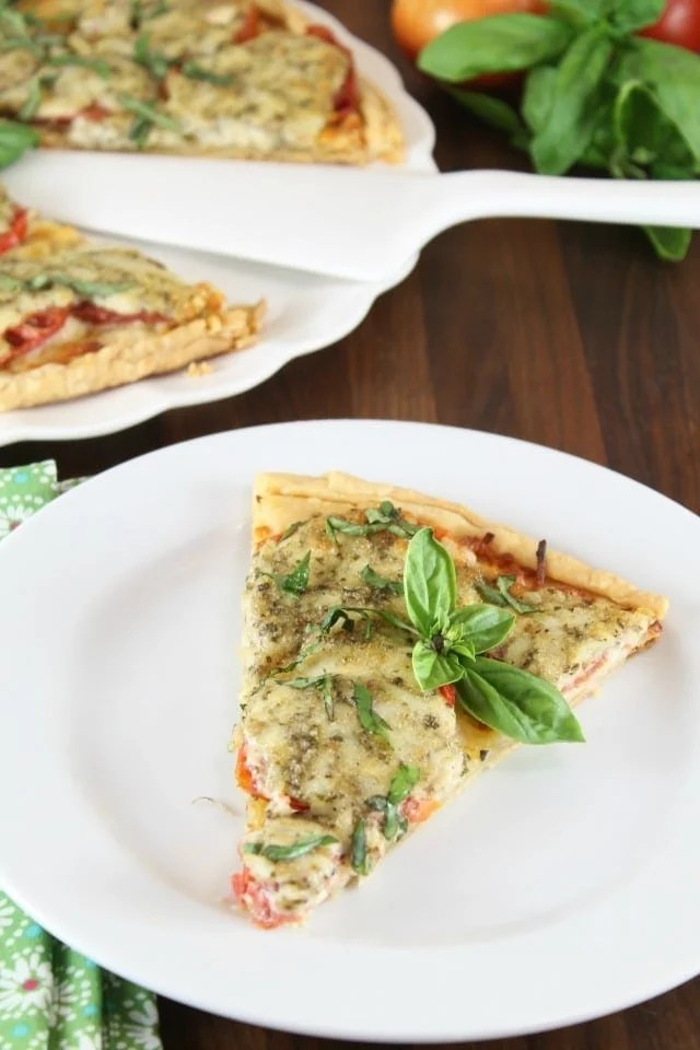 Tomato Pesto Tart Recipe from Southern Living Magazine. A summer favorite appetizer ~ MissintheKitchen.com