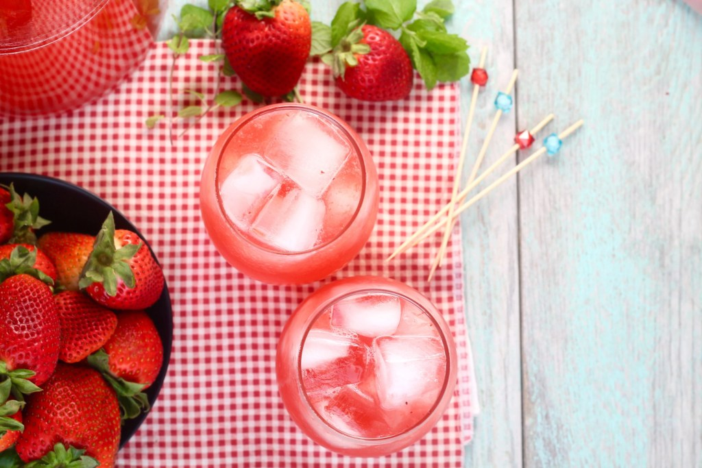 Easy Strawberry Wine Cocktail in stemless wine glasses with a bowl of strawberries