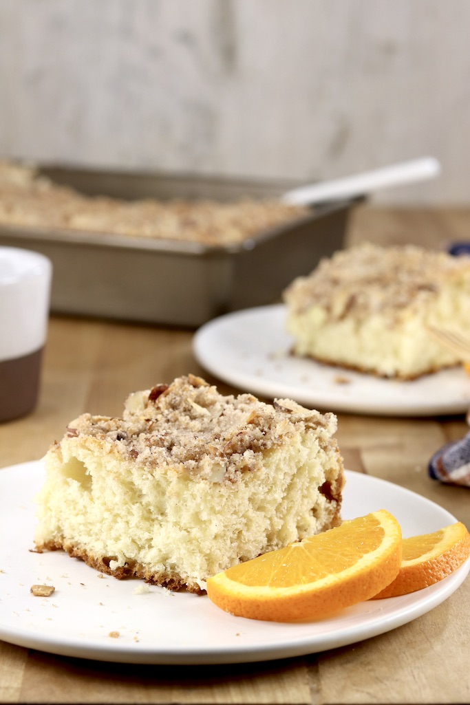 Coffee cake on 2 plates, cake pan in background