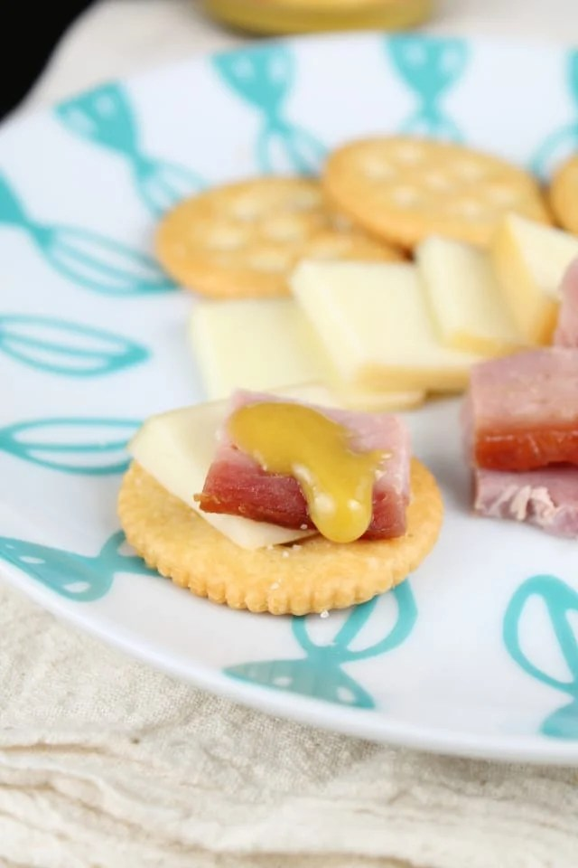 Maille Mustard with smoked cheese, ham and crackers