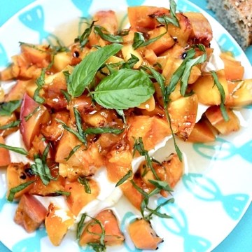 grilled peaches with basil and honey over cream cheese