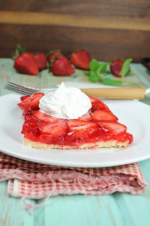 This Strawberry Slab Pie is a spin on my favorite fresh strawberry pie. Perfect for picnics and cookouts. From MissintheKitchen.com